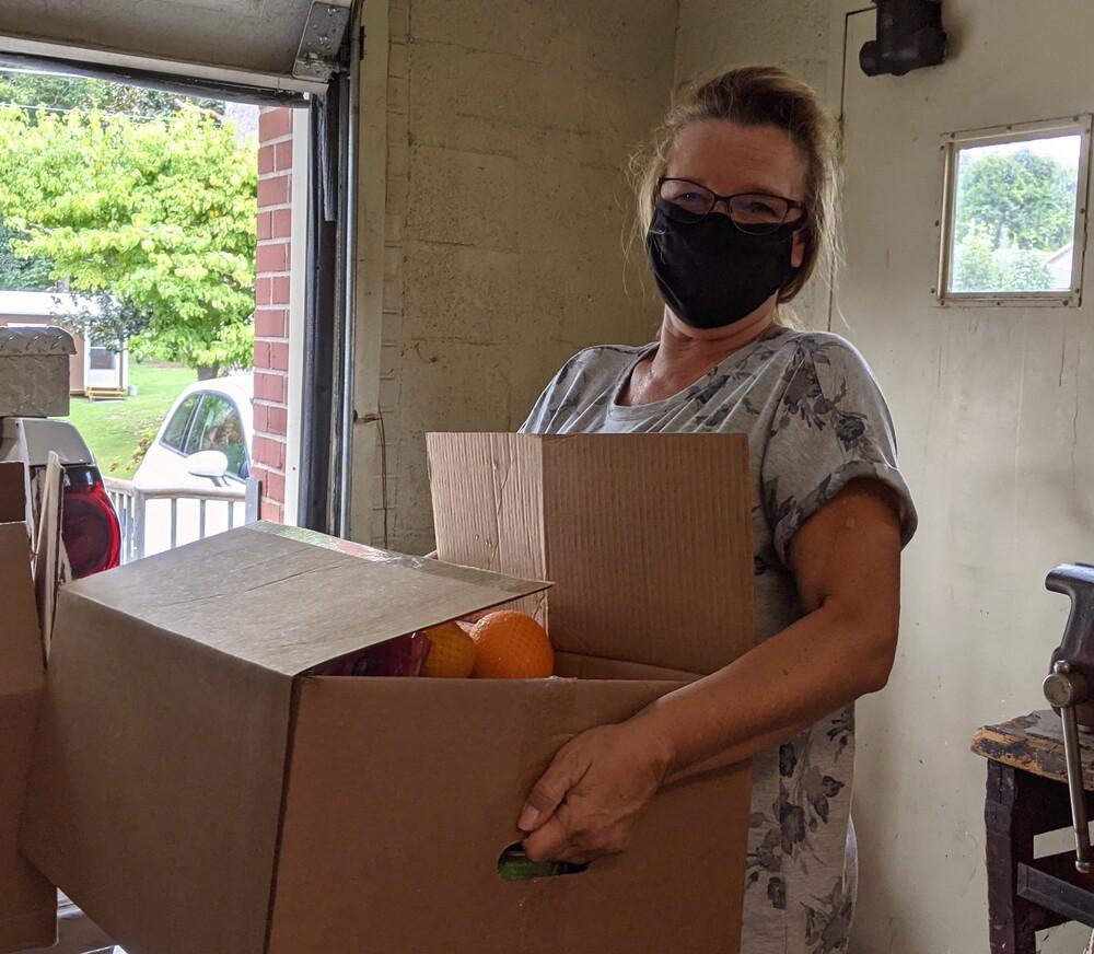 Female volunteer holding box