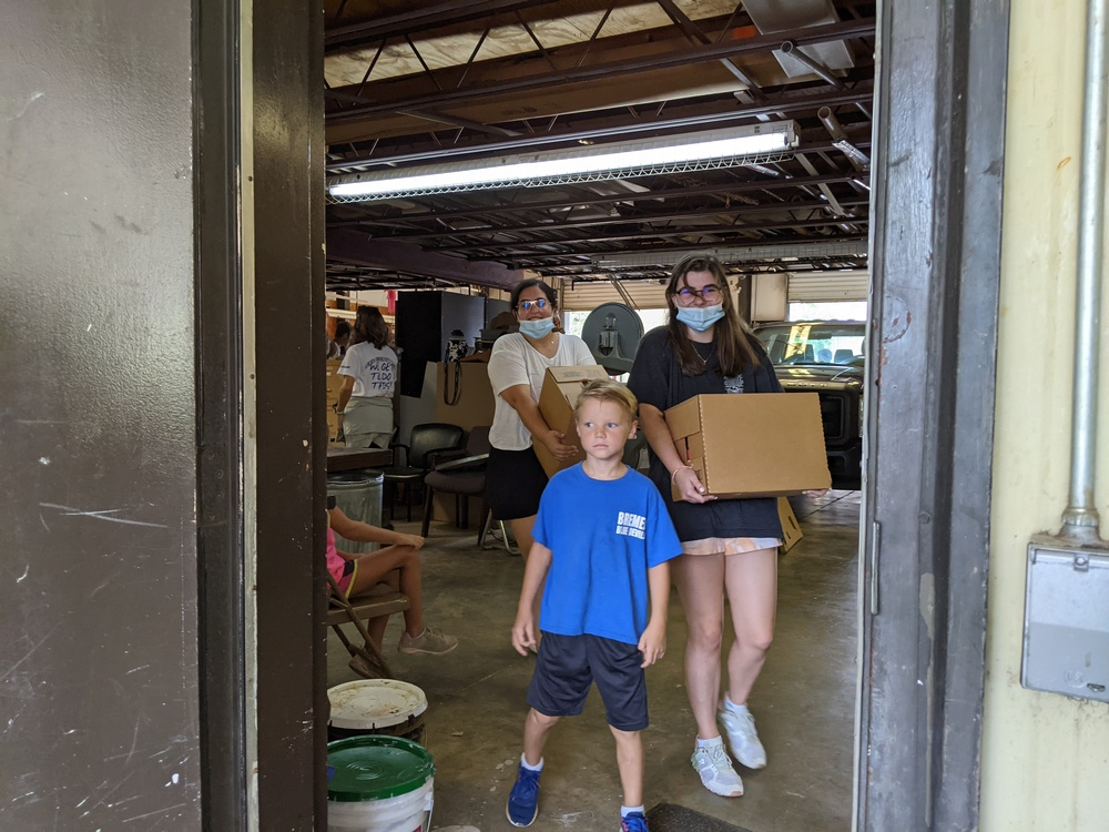 youth volunteers with boxes walking