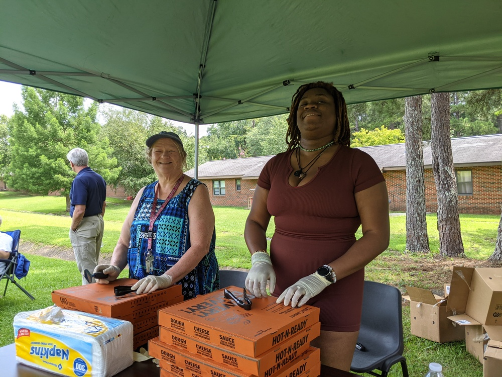 volunteers with pizza boxes