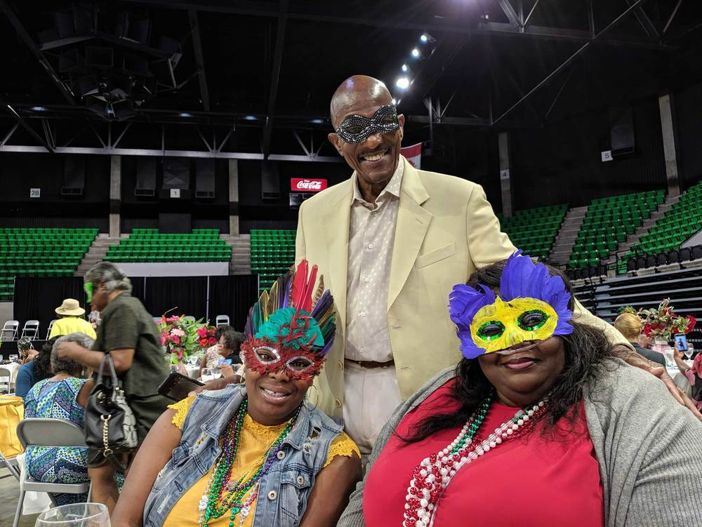 Resident Advisory Board Members at Conference Mardi Gras Theme