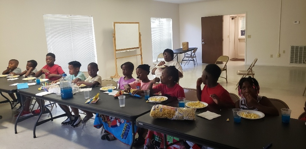 Lafayette youth watching movie and eating popcorn during summer camp