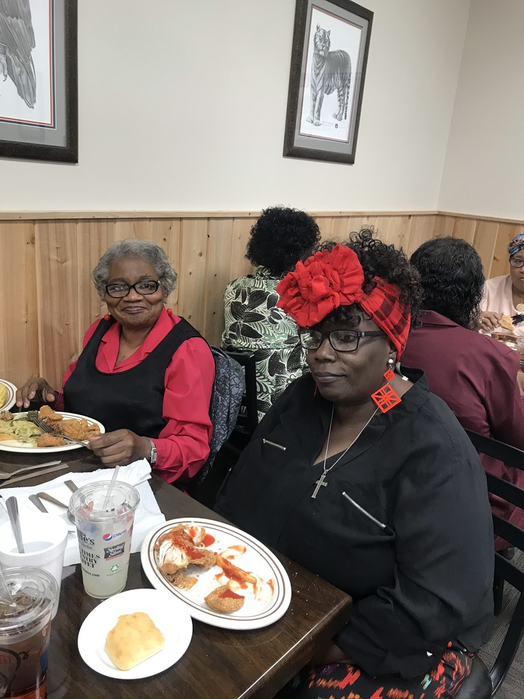 Two senior residents eating at our holiday luncheon