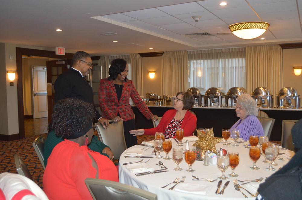 CEO Sharon Tolbert, husband, and employees at Christmas Luncheon in LHA newsletter