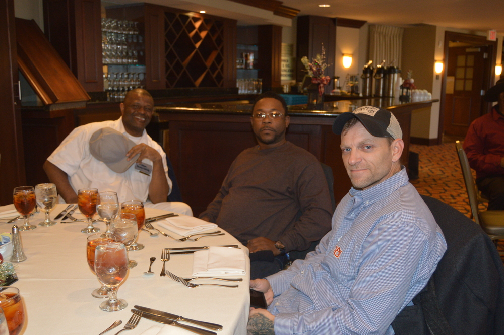 maintenance staff at holiday luncheon in lha newsletter