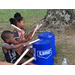 Kids using buckets for drums